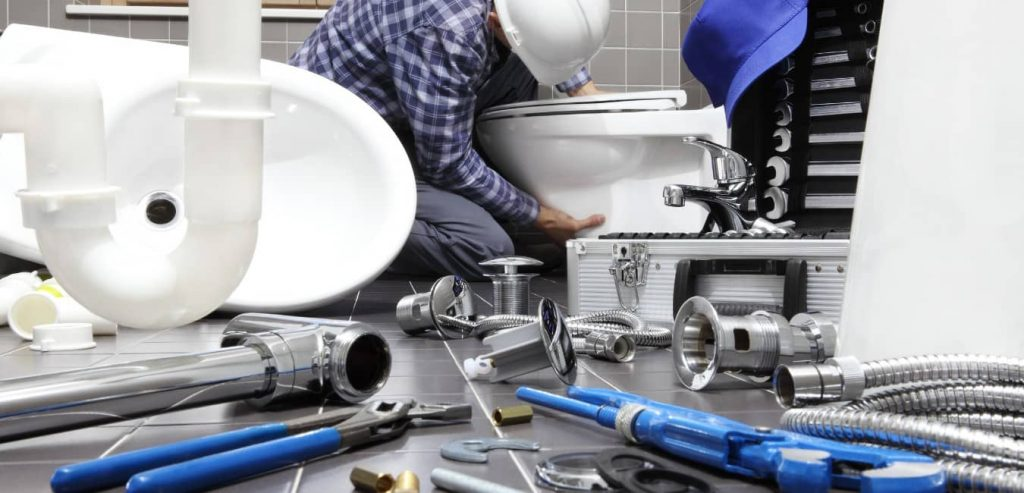 plumbers-in-blue-suits-blue-plaid-shirt-ready-to-repair-a-pipe